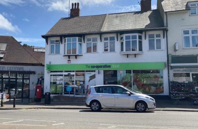 Cooperative shop acquired for investment